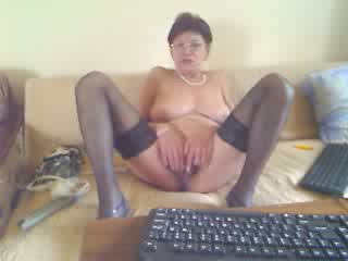 Naughty granny masturbates on webcam